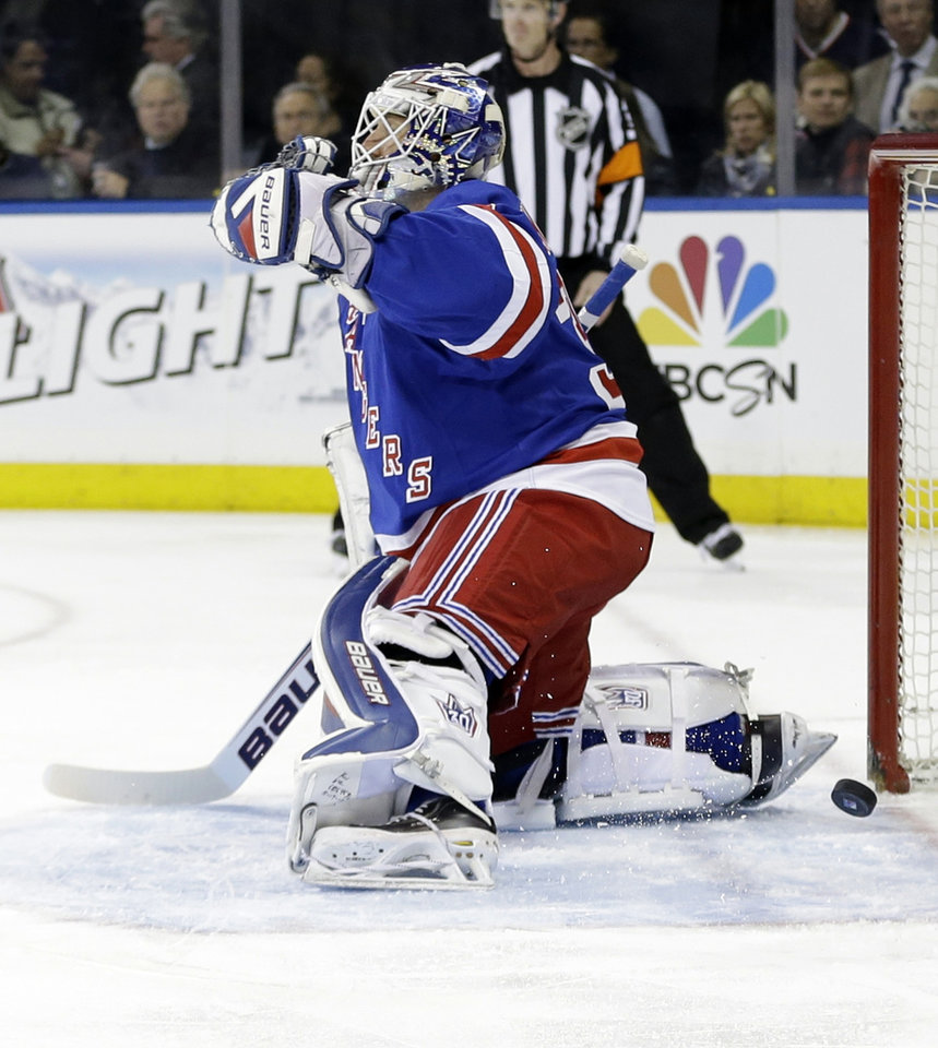Photo - New York Rangers goalie Henrik Lundqvist, of Sweden, reacts after a puck shot by Philadelphia Flyers' Andrew MacDonald got past him for a goal during the first period in  Game 1 of an NHL hockey first-round playoff series on Thursday, April 17, 2014, in New York. (AP Photo/Frank Franklin II)