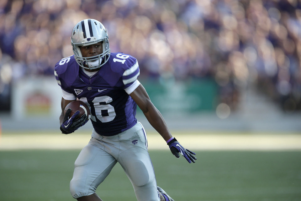 Photo - Kansas State wide receiver Tyler Lockett runs the ball during the first half of an NCAA college football game against Louisiana-Lafayette Saturday, Sept. 7, 2013, in Manhattan, Kan. (AP Photo/Charlie Riedel)  Charlie Riedel - AP