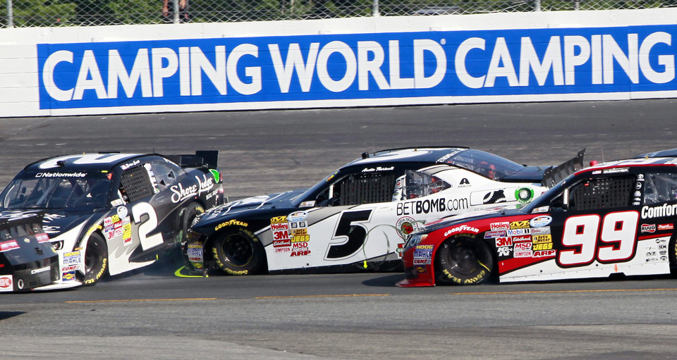 Photo - Brian Scott (2) spins out as Austin Theriault  (5) and James Buescher (99) try to avoid hitting him during the NASCAR Nationwide Series auto race at New Hampshire Motor Speedway Saturday, July 12, 2014, in Loudon, N.H. (AP Photo/Jim Cole)