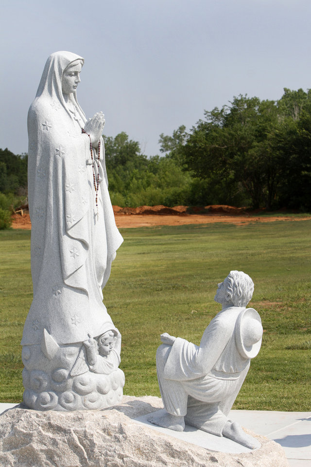 Photo - The Our Lady of Guadalupe statue at Sunny Lane Cemetery includes the kneeling figure of Juan Diego, the peasant who is said to have seen an apparition of Our Lady near Mexico City, Mexico in 1531.   Steve Gooch - The Oklahoman