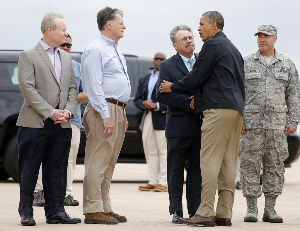Photo - President Barack Obama greets Midwest City Mayor Jack Fry, U.S. Rep. Tom Cole and Oklahoma City Mayor Mick Cornett  after landing at Tinker Air Force Base in Midwest City, Okla., Sunday, May 25, 2013. Photo by Bryan Terry, The Oklahoman