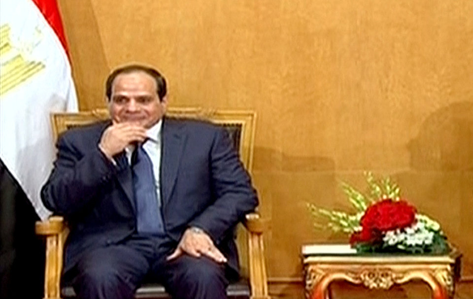 Photo - This image made from Egyptian State Television shows, soon to be sworn in President Abdel-Fattah el-Sissi, at the Supreme Constitutional Court in Cairo, Egypt, Sunday, June 8, 2014. El-Sissi's inauguration Sunday comes less than a year after the 59-year-old career infantry officer ousted the country's first freely elected president, the Islamist Mohammed Morsi, following days of mass protests by Egyptians demanding he step down. (AP Photo/Egyptian State Television)