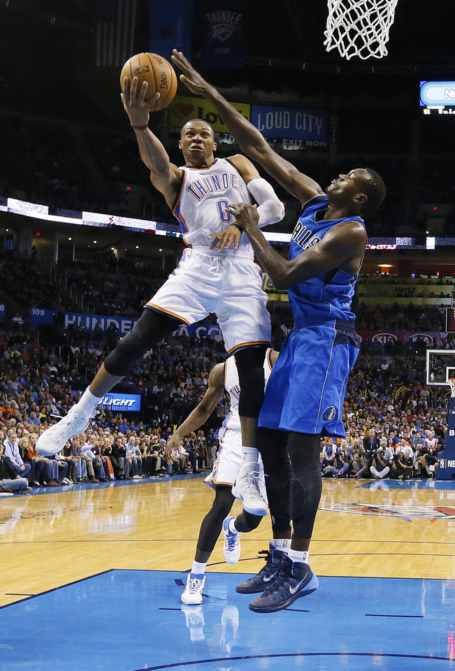 Oklahoma City�s Russell Westbrook, left, drives past Dallas� Samuel Dalembert during Wednesday�s game at Chesapeake Energy Arena.  Photo by Chris Landsberger, The Oklahoman