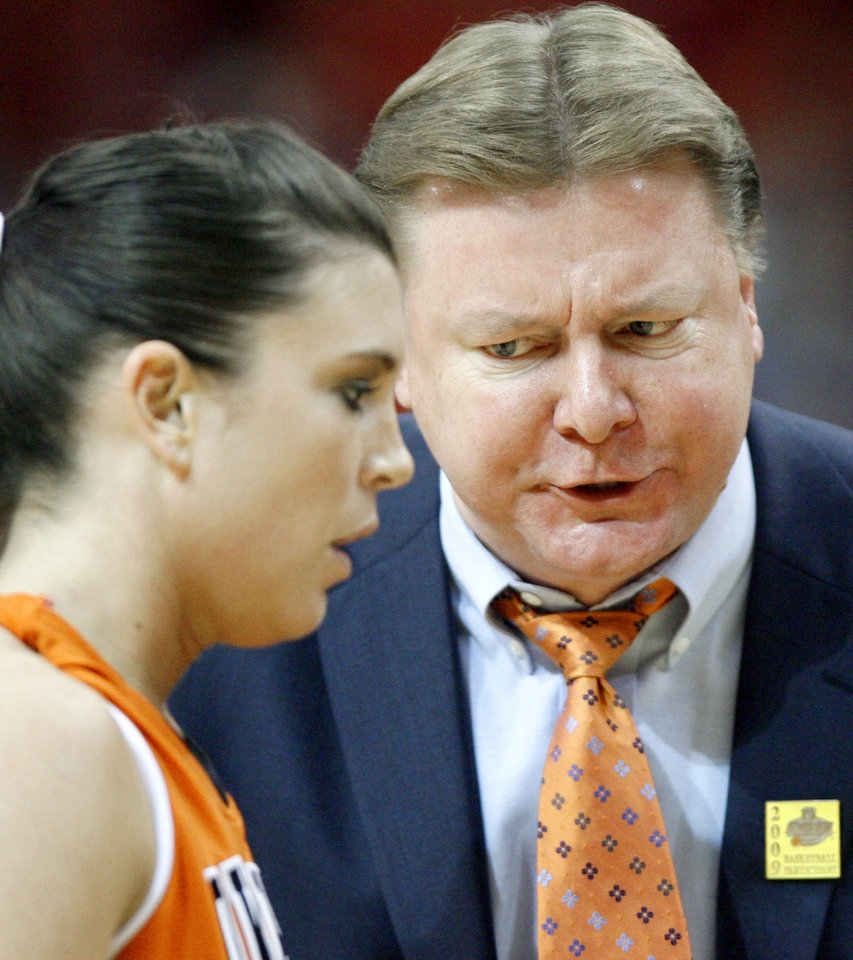 Photo - OSU coach Kurt Budke talks with Melinda Mercardo during the Big 12 Women's Championship game between Oklahoma State and Baylor at the Cox Center in Oklahoma City, Friday, March 13, 2009.  OSU lost to Baylor 67-62. PHOTO BY BRYAN TERRY, THE OKLAHOMAN