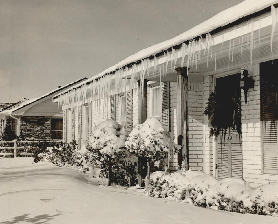 Photo - Dec. 22, 1954: Icicles hang on the eve of this Nichols Hills home at 1701 Dorchester Place. [Photo by Bob Albright, The Oklahoman Archives]