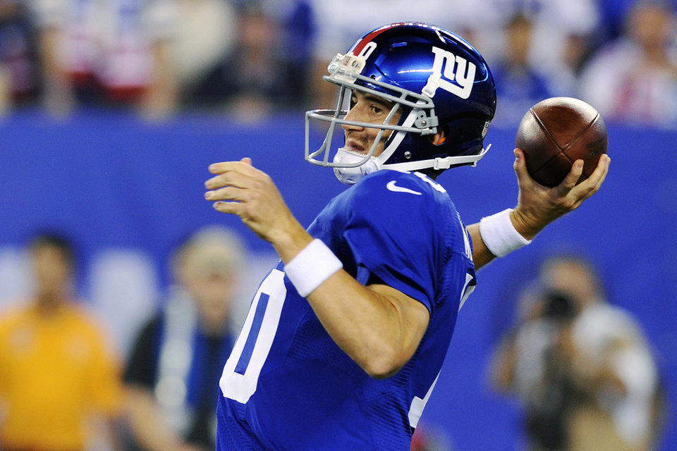 Photo -   New York Giants quarterback Eli Manning (10) throws a pass during the first half of an NFL football game against the Dallas Cowboys, Wednesday, Sept. 5, 2012, in East Rutherford, N.J. (AP Photo/Bill Kostroun)