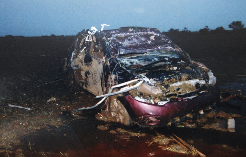 Photo - Copy photo of Becky Brown car destroyed in the May 24, 2011 tornado, Wednesday, May 16, 2012.   Photo provided. Copied By David McDaniel/The Oklahoman