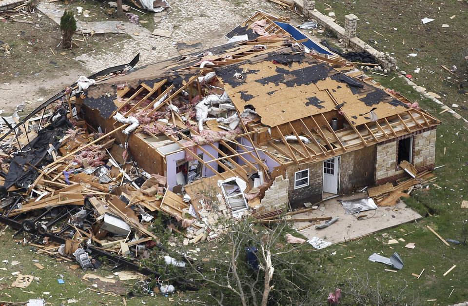 Photo - A heavily damaged home in Granbury, Texas is seen in an aerial view on Thursday May 16, 2013. Ten tornadoes touched down in several small communities in North Texas overnight, leaving at least six people dead, dozens injured and hundreds homeless.    (AP Photo/The Fort Worth Star-Telegram, Ron T. Ennis)  MAGS OUT