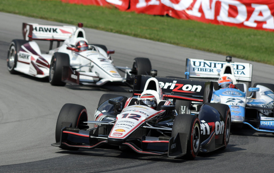 Photo - Will Power, of Australia, goes through a corner ahead of James Hinchcliffe, of Canada, right,  and Juan Pablo Montoya, of Colombia, during the IndyCar Honda Indy 200 auto racing at Mid-Ohio Sports Car Course in Lexington, Ohio Sunday, Aug. 3, 2014. (AP Photo/Tom E. Puskar)