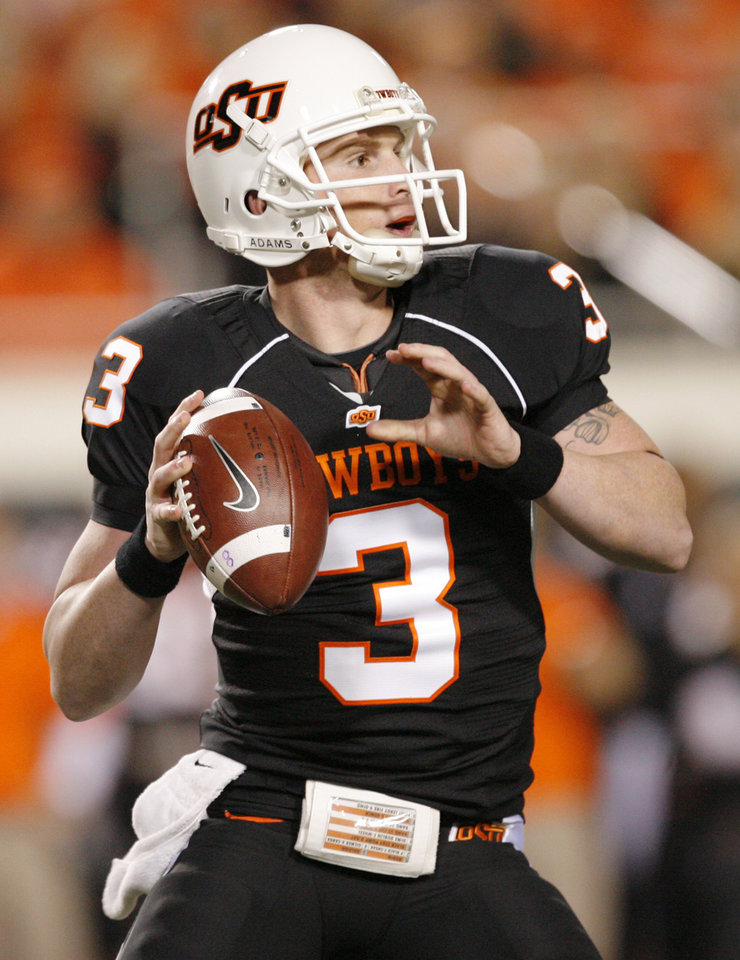 Photo - OSU's Alex Cate (3) passes during the college football game between Oklahoma State University (OSU) and the University of Colorado (CU) at Boone Pickens Stadium in Stillwater, Okla., Thursday, Nov. 19, 2009. Photo by Nate Billings, The Oklahoman