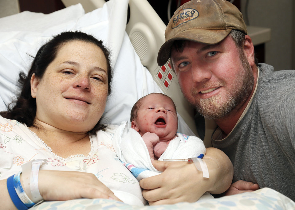 Robin Martin and Ben Martin pose for a photo with their newborn son, Easton Martin, at Integris Baptist Medical Center on Wednesday in Oklahoma City. Easton was born by cesarean section at 12:12 and 12 seconds on 12-12-12.  Photo by Nate Billings, The Oklahoman