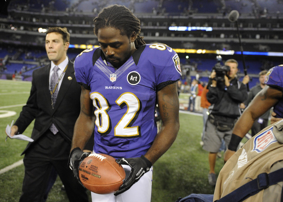 Photo -   Baltimore Ravens wide receiver Torrey Smith walks off the field after an NFL football game against the New England Patriots in Baltimore, Sunday, Sept. 23, 2012. Baltimore won 31-30. Smith, who was playing less than 24 hours after the death of his 19-year-old brother, had six catches for 127 yards and two touchdowns for the Ravens. (AP Photo/Nick Wass)