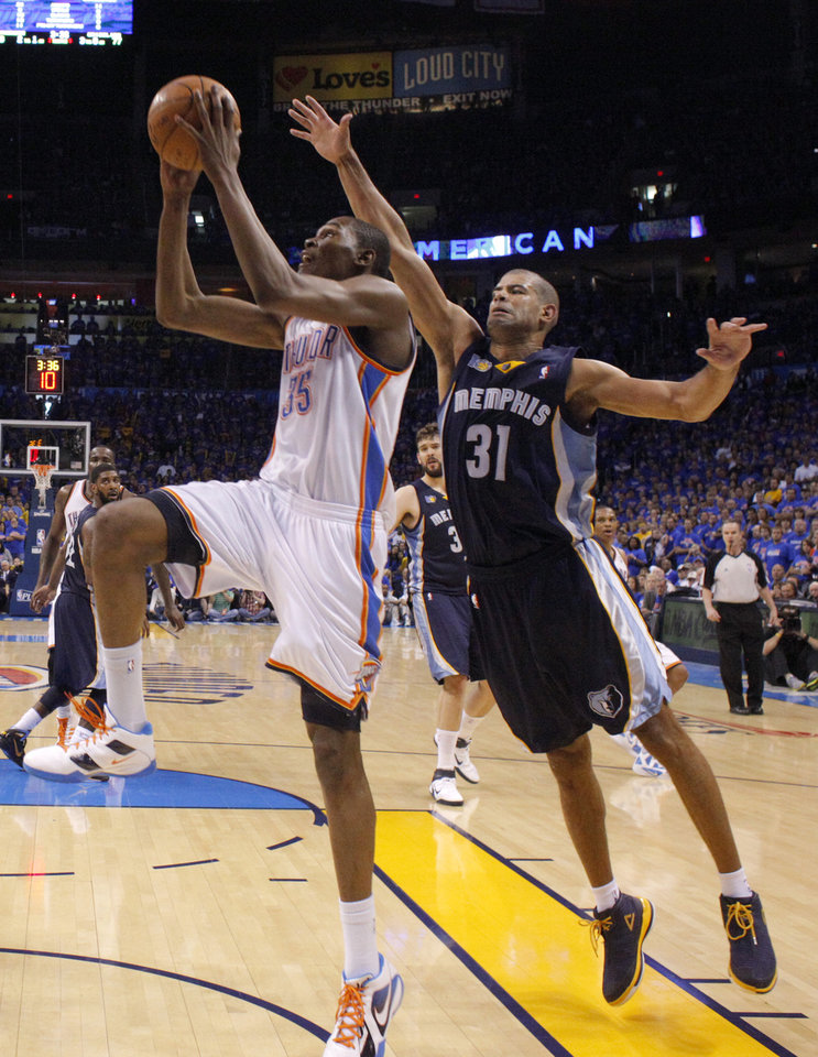 Oklahoma City's Kevin Durant (35) drives to the basket as Shane Battier (31) of Memphis defends during game 7 of the NBA basketball Western Conference semifinals between the Memphis Grizzlies and the Oklahoma City Thunder at the OKC Arena in Oklahoma City, Sunday, May 15, 2011. Photo by Sarah Phipps, The Oklahoman