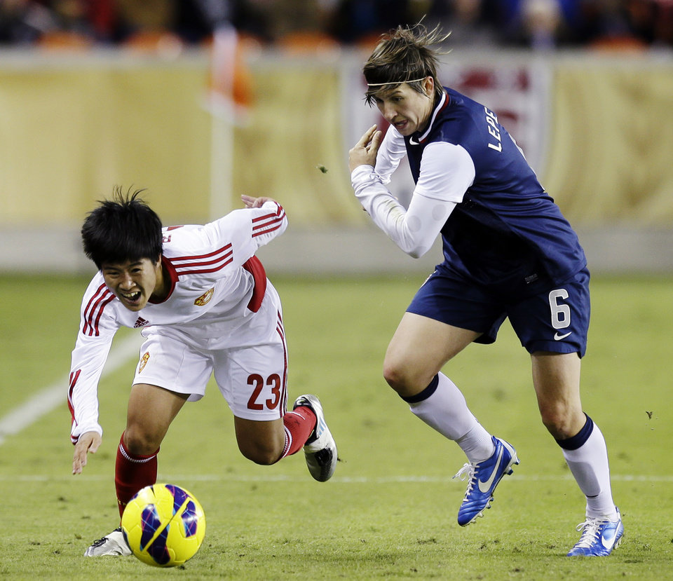 China\'s Ren Guixin and United States\' Amy LePeilbet (6) go after the ball during the second half of an exhibition soccer match Wednesday, Dec. 12, 2012, in Houston. (AP Photo/David J. Phillip)