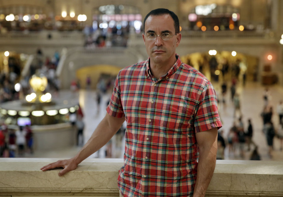 Photo - In this July 22, 2014 photo, AIDS activist Gregg Gonsalves poses for photos in New York's Grand Central Terminal. In the early 1990s, Gonsalves traveled to Washington to confront, provoke and challenge officials at the Food and Drug Administration. A quarter century later, he still travels to Washington, but with a very different agenda: to defend the FDA. (AP Photo/Richard Drew)