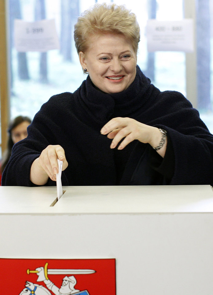 Lithuania\'s President Dalia Grybauskaite casts her ballot at a polling station in Vilnius, Lithuania, Sunday, Oct. 14, 2012. Lithuanians are expected to deal a double-blow to the incumbent conservative government in national elections Sunday by handing a victory to opposition leftists and populists and saying \'no\' to a new nuclear power plant that supporters claim would boost the country\'s energy independence. (AP Photo/Mindaugas Kulbis)