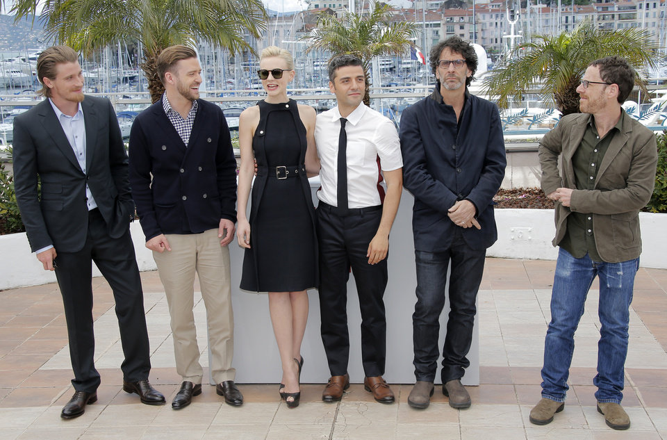 Photo - From left, actors Garrett Hedlund, Justin Timberlake, Carey Mulligan, Oscar Isaac, and directors Joel and Ethan Coen pose for photographers during a photo call for the film Inside Llewyn Davis at the 66th international film festival, in Cannes, southern France, Sunday, May 19, 2013. (AP Photo/Lionel Cironneau)