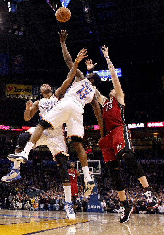 Photo - Oklahoma City's Daequan Cook (14) and Oklahoma City's James Harden (13) pressure Miami's Mike Miller (13) during the NBA basketball game between Oklahoma City and Miami at the OKC Arena in Oklahoma City, Thursday, Jan. 30, 2011. Photo by Sarah Phipps, The Oklahoman