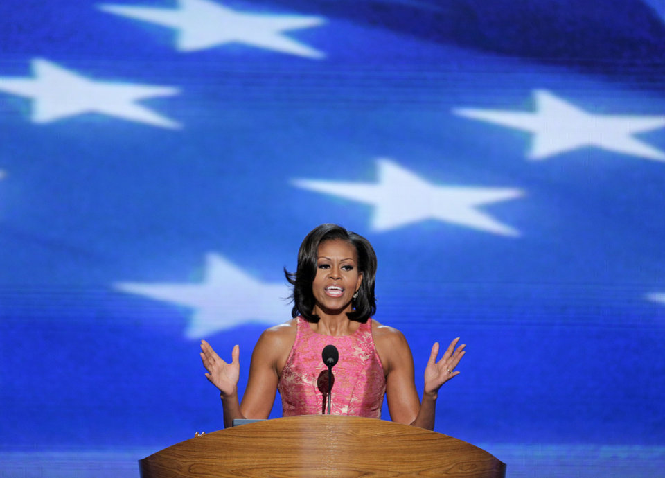 Photo - First Lady Michelle Obama addresses the Democratic National Convention in Charlotte, N.C., on Tuesday, Sept. 4, 2012. (AP Photo/J. Scott Applewhite)  ORG XMIT: DNC192