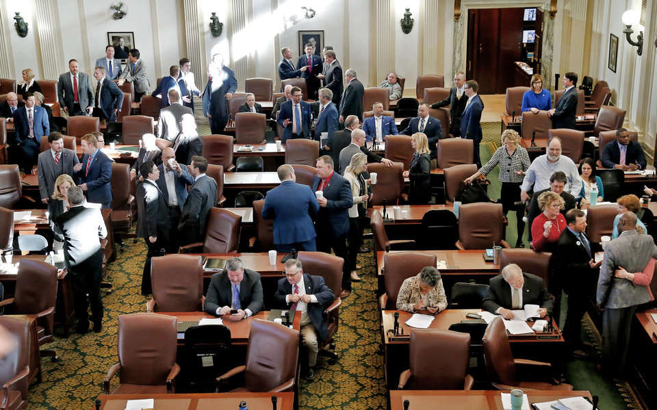 Photo -  State lawmakers meet at the state Capitol on Tuesday to organize and elect leaders. They also held a brief joint session. [Photo by Jim Beckel, The Oklahoman]