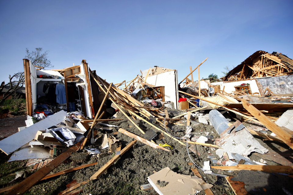 Photo - Tornado damage is pictured, Sunday April, 15, 2012.  A tornado struck Woodward early Sunday morning. Photo by Sarah Phipps, The Oklahoman.