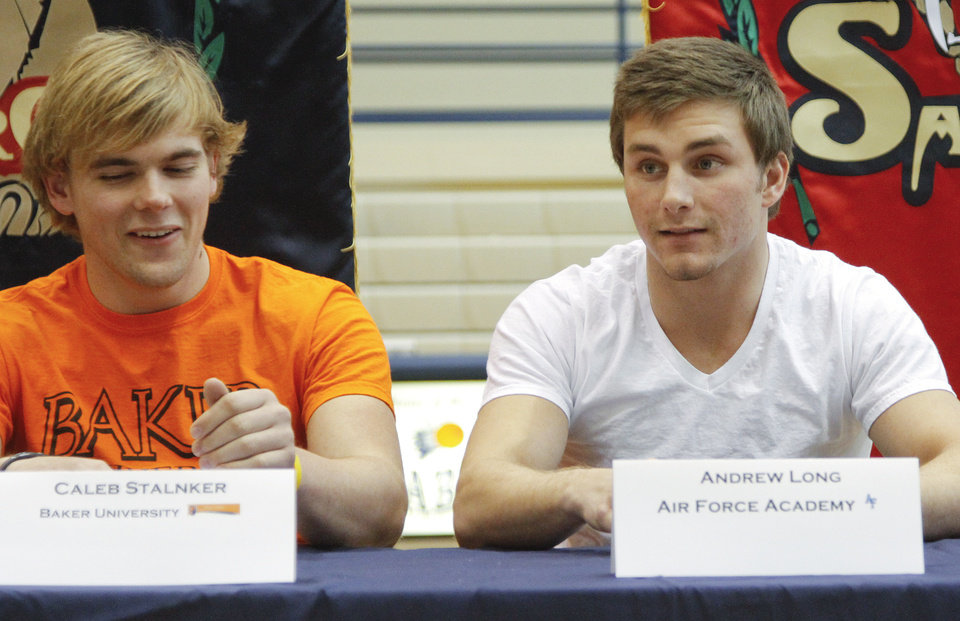 Photo - NATIONAL SIGNING DAY / SIGN / SIGNED: Southmoore High School's Andrew Long, right,  sits at a table with classmate  Caleb Stalnker after Long signed his letter of intent to play football at the Air Force Academy, and Stalnker signed to play at Baker University during National Signing Day at Southmoore High School on Wednesday, Feb. 1, 2012, in Oklahoma City, Okla. Photo by Chris Landsberger, The Oklahoman