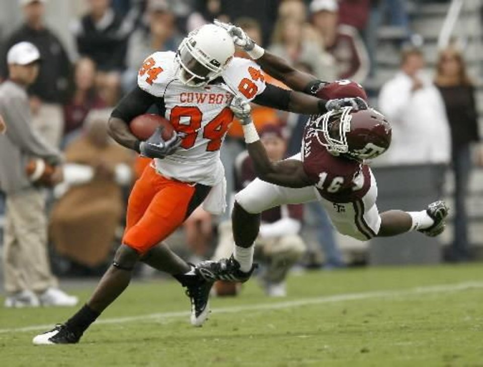 OSU's Hubert Anyiam fights off Steven Campbell of Texas A&M during the Oklahoma State-Texas A&M game at Kyle Field in College Station, Texas, Saturday, October 10, 2009. OSU won 56-28 and rides a three-game winning streak over the Aggies into Thursday's game in Stillwater. Photo by Bryan Terry, The Oklahoman.