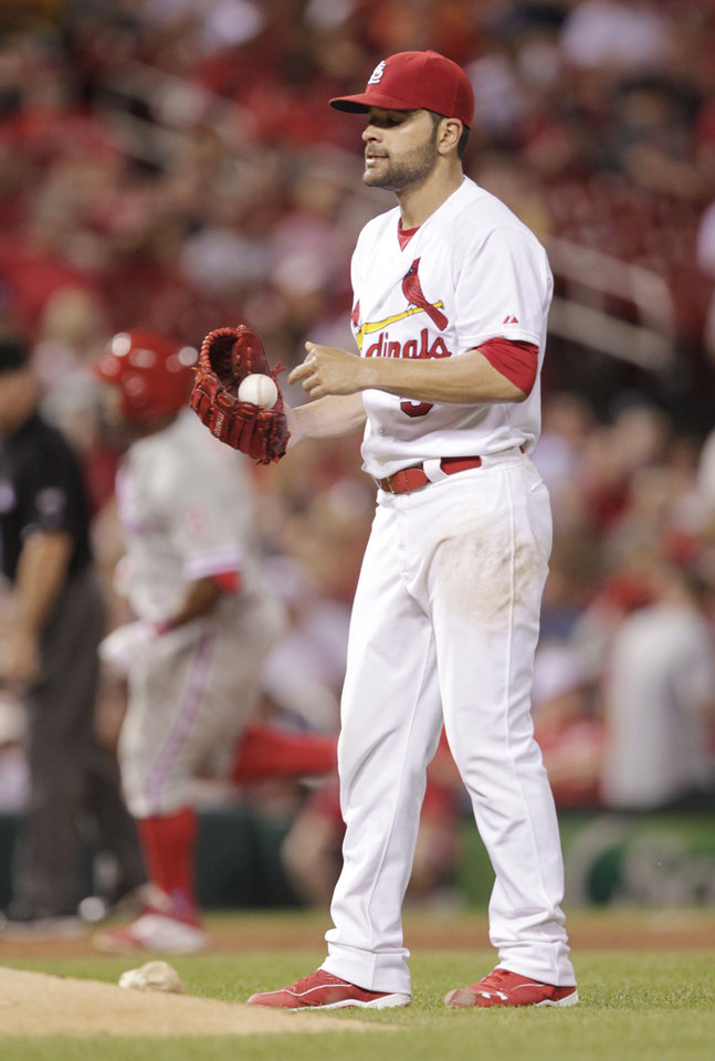 Photo - St. Louis Cardinals starting pitcher Jaime Garcia regroups as Philadelphia Phillies' Marlon Byrd circles the bases after hitting a solo home run in the sixth inning of a baseball game, Friday, June 20, 2014, in St. Louis. (AP Photo/Tom Gannam)
