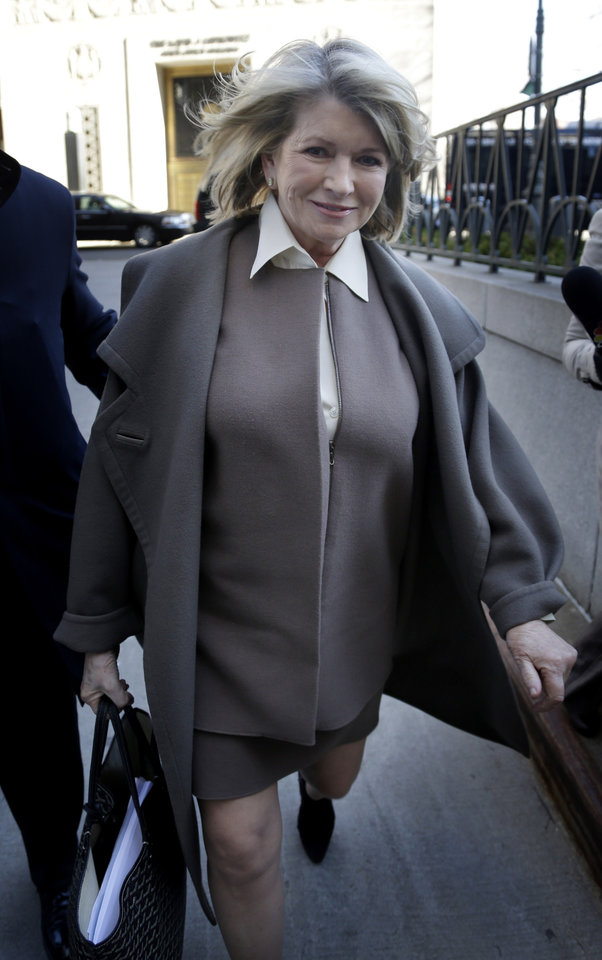 Photo - Martha Stewart arrives at New York State Supreme Court in New York, Tuesday, March 5, 2013. Stewart, 71, is scheduled to take the stand Tuesday in a legal battle between two of the nation's largest retailers — Macy's Inc. and J.C. Penney Co. Macy's sued the media and merchandising company Stewart founded for breaching an exclusive contract when she signed a deal with Penney in December 2011 to open shops at most of its stores this spring. (AP Photo/Seth Wenig)