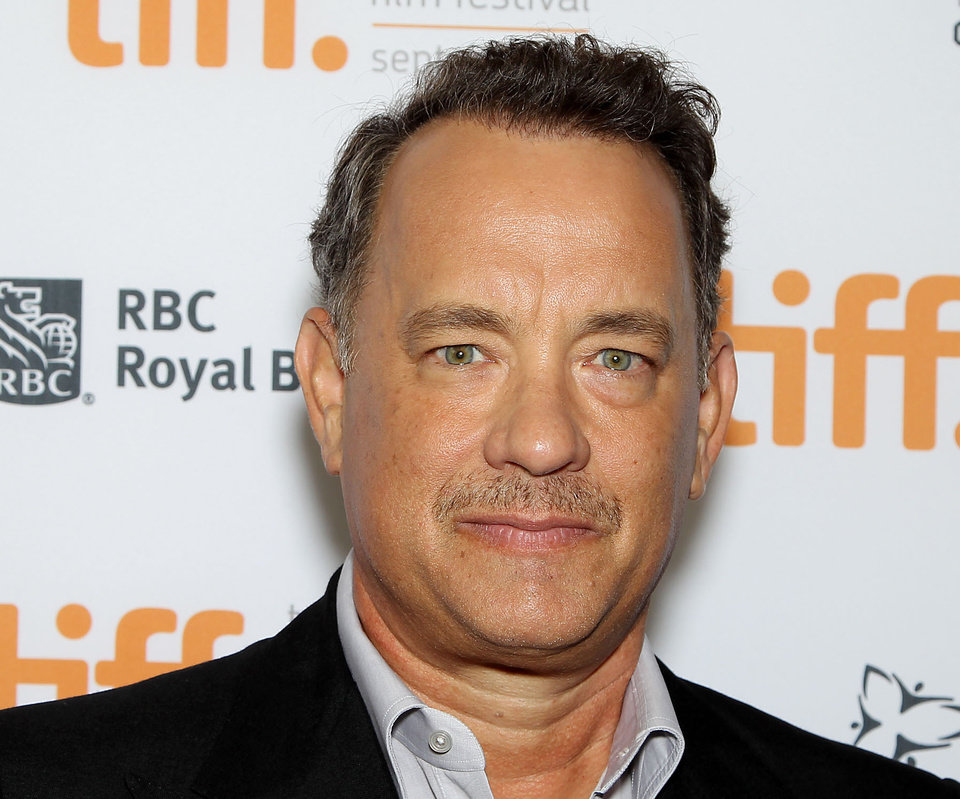 Photo -   FILE - This Sept. 8, 2012 file image released by Stapix shows actor Tom Hanks at the premiere of