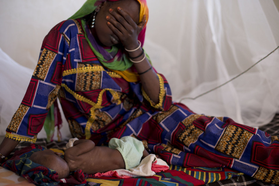 Photo - ADVANCE FOR SATURDAY DEC 22, 2012 In this Oct. 31, 2012 photo, Harmata Mahamat reacts as she sits with her daughter Halime, 3 months, at a local nutrition clinic where Halime was being treated for malnutrition, in Nokou in the Mao region of Chad. Halime died several days later. In this Sahel nation, childhood malnutrition and related mortality persist at alarming rates, despite the fact that most affected families live within a day's journey of internationally-funded nutrition clinics. One reason is that families, bound by local custom, choose instead to seek traditional treatments, treatments which can lead to the very infections that kill their undernourished children.(AP Photo/Rebecca Blackwell) Chad. In this Sahel nation, childhood malnutrition and related mortality persist at alarming rates, despite the fact that most affected families live within a day's journey of internationally-funded nutrition clinics. One reason is that families, bound by local custom, choose instead to seek traditional treatments, treatments which can lead to the very infections that kill their undernourished children.(AP Photo/Rebecca Blackwell)