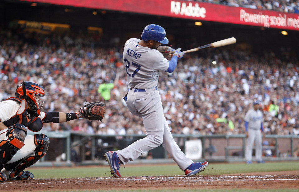 Photo - Los Angeles Dodgers' Matt Kemp (27) hits a single during the fifth inning of a baseball game against the San Francisco Giants, Saturday, July 26, 2014, in San Francisco. (AP Photo/Beck Diefenbach)
