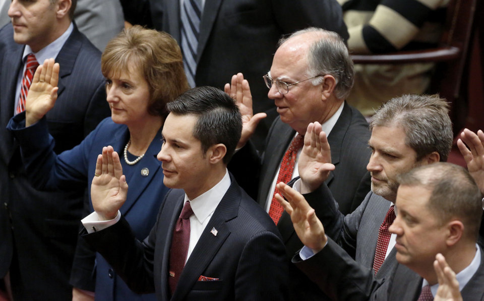 Senators raise their right hands to be sworn in Wednesday at the state Capitol. Photo by Jim Beckel, The Oklahoman