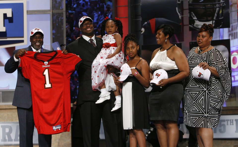 Photo - Oklahoma defensive tackle Gerald McCoy, second from left, poses with family and friends after he was selected as the third overall pick by the Tampa Bay Buccaneers in the first round of the NFL football draft at Radio City Music Hall Thursday, April 22, 2010, in New York. (AP Photo/Jason DeCrow)
