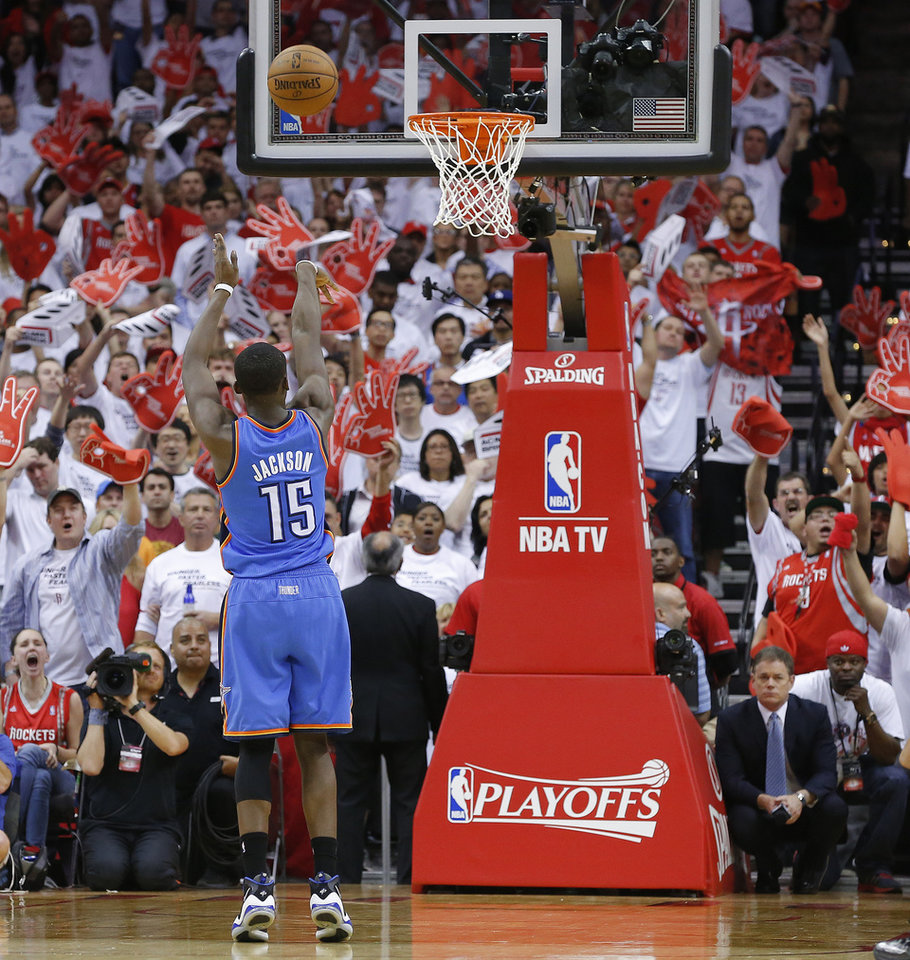 Oklahoma City\'s Reggie Jackson (15) shoots a free throw in the final seconds of Game 3 in the first round of the NBA playoffs between the Oklahoma City Thunder and the Houston Rockets at the Toyota Center in Houston, Texas, Sat., April 27, 2013. Oklahoma City won 104-101. Photo by Bryan Terry, The Oklahoman