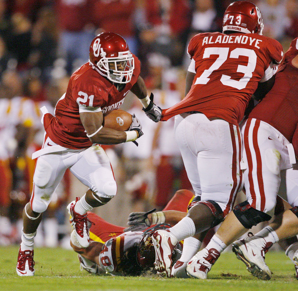 Photo - Brennan Clay (21) follows the block of Josh Aldenoye (73) during the second half of the college football game between the University of Oklahoma Sooners (OU) and the Iowa State Cyclones (ISU) at the Gaylord Family-Oklahoma Memorial Stadium on Saturday, Oct. 16, 2010, in Norman, Okla.  Photo by Steve Sisney, The Oklahoman