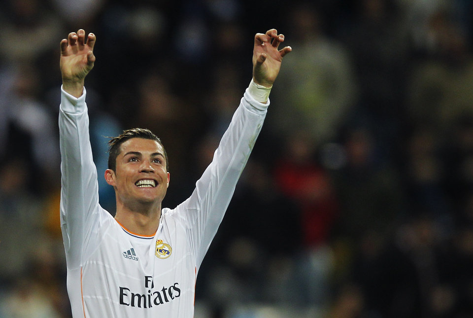 Photo - FILE - The Jan. 6, 2013 file photo shows Real Madrid's Cristiano Ronaldo from Portugal celebrating his goal during a Spanish La Liga soccer match between Real Madrid and Celta at the Santiago Bernabeu stadium in Madrid. Ronaldo is one of the three candidates as the world's best soccer player  to be awarded at the FIFA Ballon d'Or gala on Monday, Jan 13, 2014. (AP Photo/Andres Kudacki)