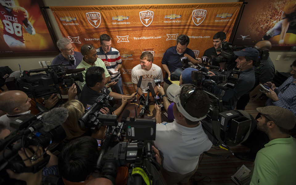 Photo - Texas NCAA college football quarterback David Ash speaks to the media during a press conference after practice on Monday, Aug. 4, 2014.  (AP Photo/Austin American-Statesman, Ricardo B. Brazziell)  AUSTIN CHRONICLE OUT, COMMUNITY IMPACT OUT, INTERNET AND TV MUST CREDIT PHOTOGRAPHER AND STATESMAN.COM, MAGS OUT