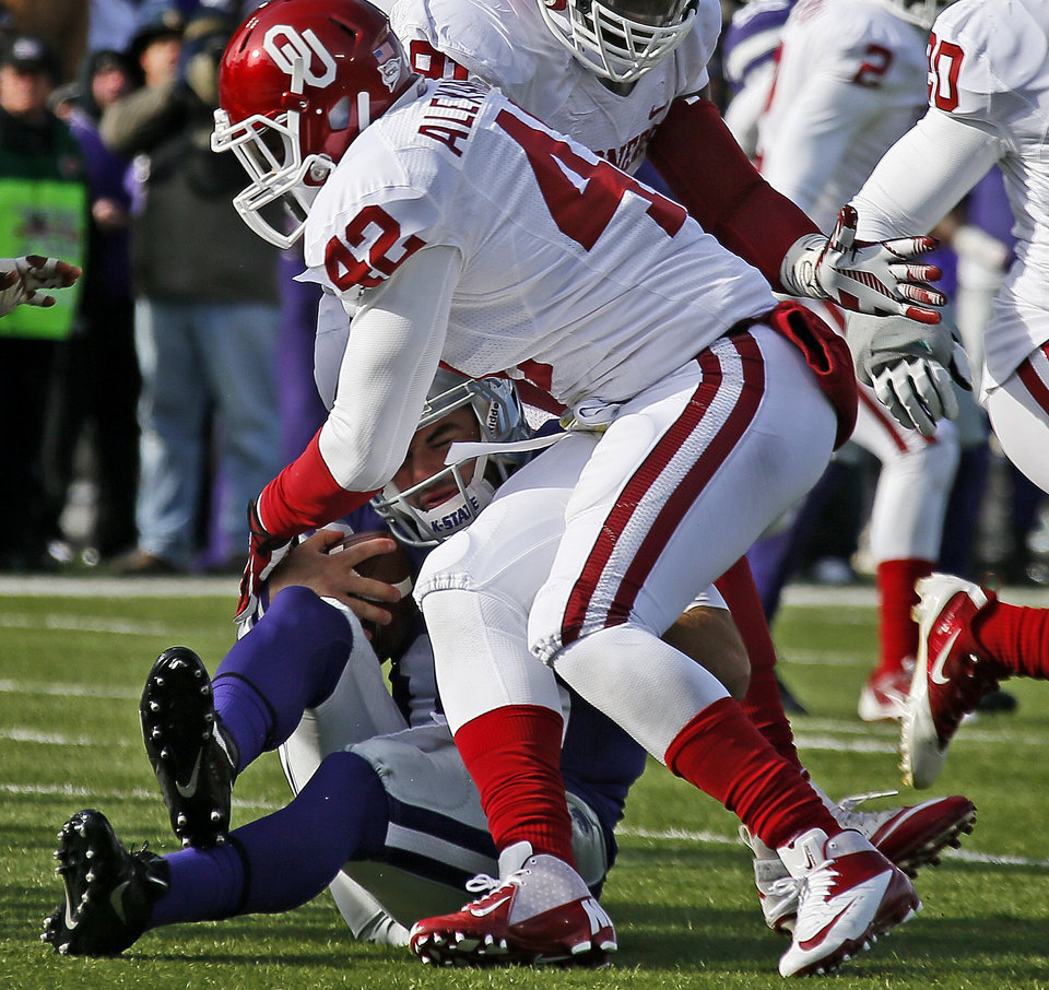 Oklahoma's Dominique Alexander (42) brings down Kansas State's Jake Waters (15) during an NCAA college football game between the Oklahoma Sooners and the Kansas State University Wildcats at Bill Snyder Family Stadium in Manhattan, Kan., Saturday, Nov. 23, 2013. Oklahoma won 41-31. Photo by Bryan Terry, The Oklahoman