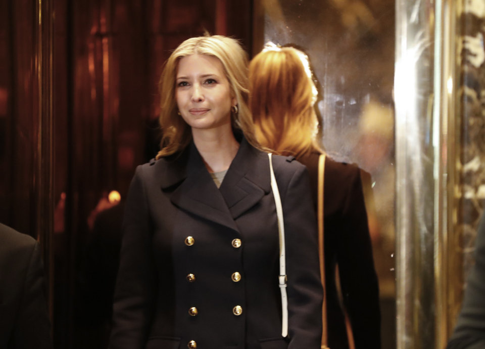Photo - Ivanka Trump, daughter of President-elect Donald Trump, looks out of an elevator as she arrives as at Trump Tower, Monday, Nov. 21, 2016 in New York. AP Photo/Carolyn Kaster)