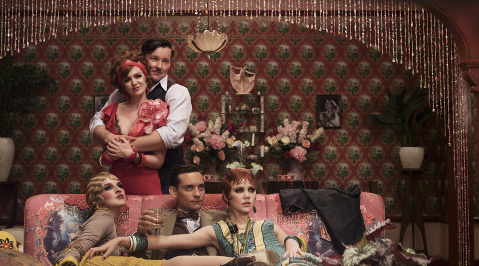 "Photo - FILE -This undated publicity photo released by courtesy of Warner Bros. Pictures shows, clockwise from top left, Isla Fisher as Myrtle Wilson, Joel Edgerton as Tom Buchanan, Adelaide Clemens as Catherine, Tobey Maguire as Nick Carraway and Kate Mulvany as Mrs. McKee in Warner Bros. Pictures' and Village Roadshow Pictures' drama, ""The Great Gatsby,"" a Warner Bros. Pictures release. (AP Photo/Warner Bros. Pictures)"