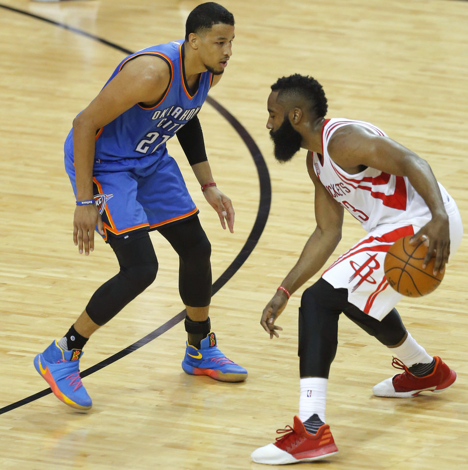 Photo - Oklahoma City's Andre Roberson (21) defends Houston's James Harden (13) during Game 5 in the first round of the NBA playoffs between the Oklahoma City Thunder and the Houston Rockets at the Toyota Center in Houston, Texas,  Tuesday, April 25, 2017.  Photo by Sarah Phipps, The Oklahoman
