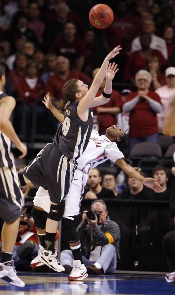 Photo - Nyeshia Stevenson is called for a foul against Jodi Howell (00) in the second half as the University of Oklahoma (OU) plays Purdue in the NCAA women's basketball regional tournament finals at the Ford Center in Oklahoma City, Okla., on Tuesday, March 31, 2009.  Photo by Steve Sisney, The Oklahoman