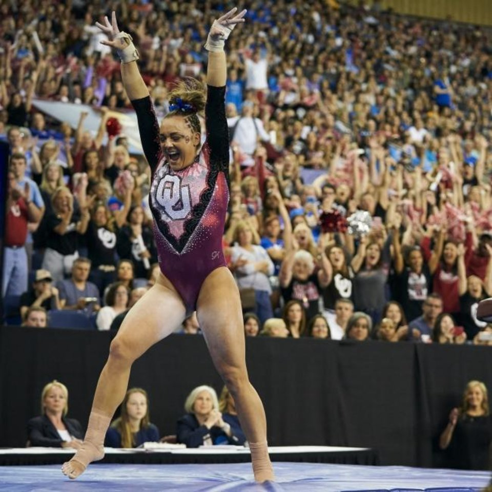 Photo -  Oklahoma's Maggie Nichols celebrates after her vault Saturday. The Sooner junior won the NCAA all-around title on Friday. [AP Photo/Cooper Neill]