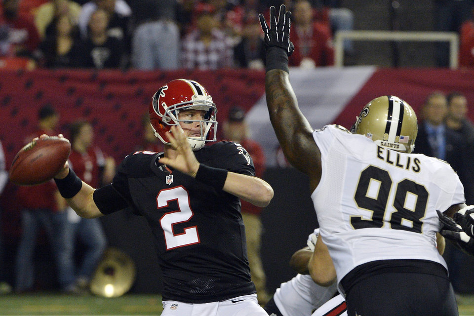 Atlanta Falcons quarterback Matt Ryan (2) throws under pressure from New Orleans Saints defensive tackle Sedrick Ellis (98) during the first half of an NFL football game, Thursday, Nov. 29, 2012, in Atlanta. (AP Photo/Rich Addicks)
