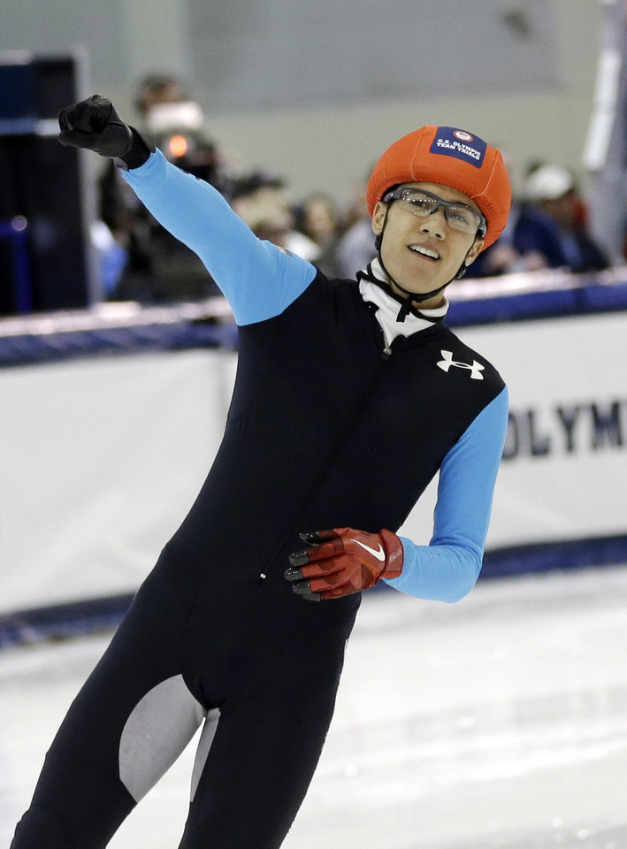 Photo - J.R. Celski reacts to the crowd after competing in a race in the men's 500 meters during the U.S. Olympic U.S. short track speedskating trials Saturday, Jan. 4, 2014, in Kearns, Utah. (AP Photo/Rick Bowmer)