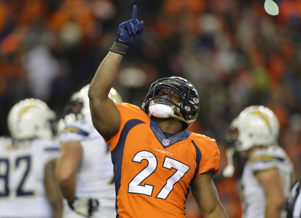 Photo - Denver Broncos running back Knowshon Moreno reacts after scoring a touchdown on a three-year run against the San Diego Chargers in the fourth quarter of an NFL AFC division playoff football game, Sunday, Jan. 12, 2014, in Denver. (AP Photo/Jack Dempsey)