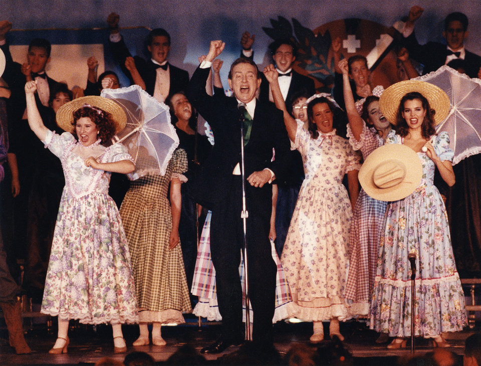 "Photo -  Ridge Bond singing ""Oklahoma!"" with the cast and choir from the University of Central Oklahoma's production of Rodgers & Hammerstein's"