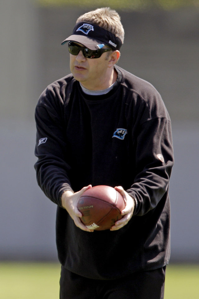 Photo - FILE - In this June 7, 2012, file photo, Carolina Panthers offensive coordinator Rob Chudzinski instructs players during an NFL football practice in Charlotte, N.C. A person familiar with the decision said Thursday, Jan. 10, 2013, that the Cleveland Browns have hired Chudzinski as their new coach. (AP Photo/Chuck Burton, File)