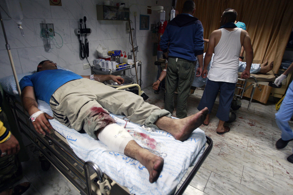 Photo - A Palestinian injured during clashes with Israeli army soldiers in the early morning is treated at a hospital in the West Bank city of Jenin, Wednesday, July 2, 2014. Tensions have mounted between Israel and the Palestinians after the bodies of three Israeli teens were found in the West Bank more than two weeks after they went missing. (AP Photo/Mohammed Ballas)